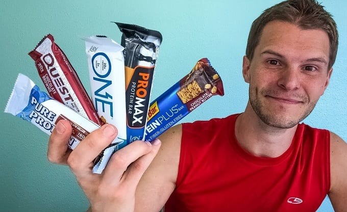 Man Holding Protein Bars In Hand