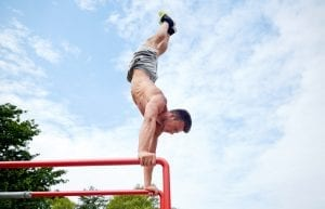exercising on parallel bars