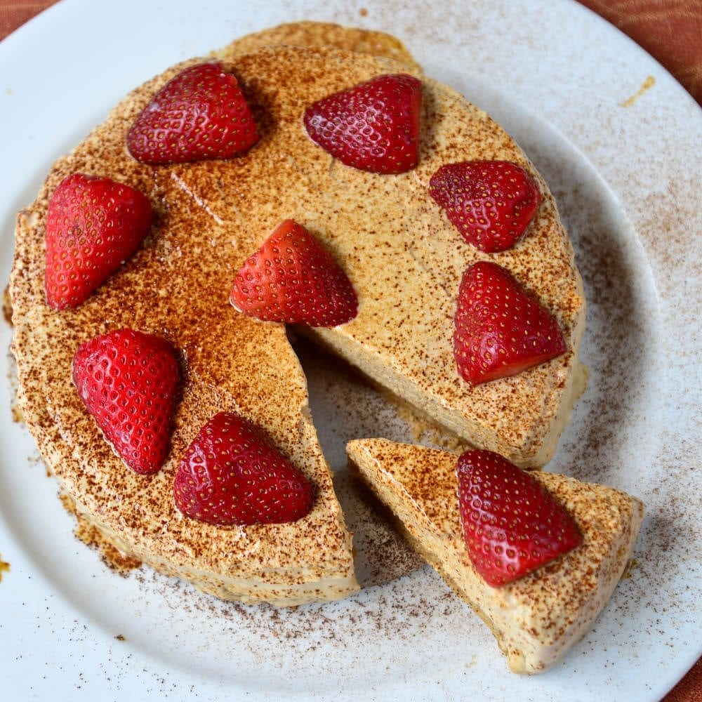 Served With Coffee Powder And Strawberries